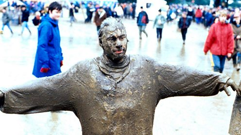 A Glastonbury festival goer covered in mud 1997