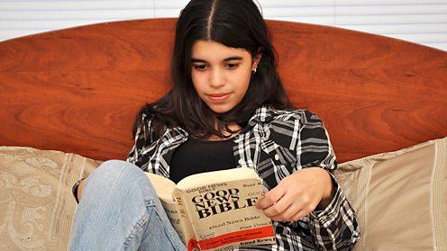 Girl reading Good News Bible