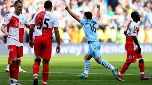 Sergio Aguero celebrates scoring the goal that won the league for Manchester City in 2012