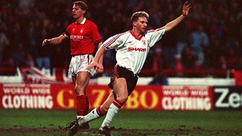 Mark Robins celebrates scoring for Manchester United.