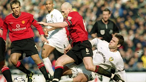 Dutch defender Jaap Stam playing for Manchester United.