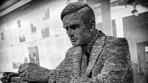 Slate statue of Mathematician Alan Turing at Bletchley Park - shutterstock_436299130