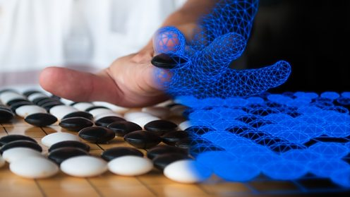Human hand playing Go game with virtual hand overlay