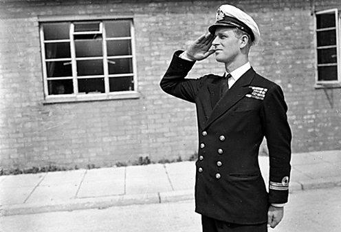 Prince Philip in naval uniform saluting at Royal Naval Officers' School, Kingsmoor Wilts.