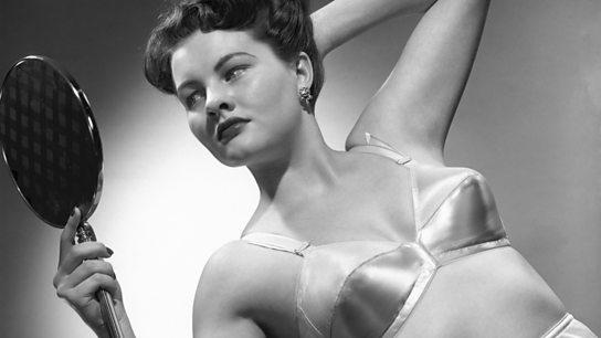 78fef7c9a 1960s land Getty Images 72499514. An underwear model wearing a bullet bra.