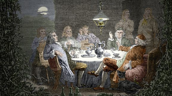 A group of industrialists and Natural Philosophers sitting around a table. They were called the 'Lunar society'. Both of Darwin's grandfathers belonged to the 'Lunar Society'