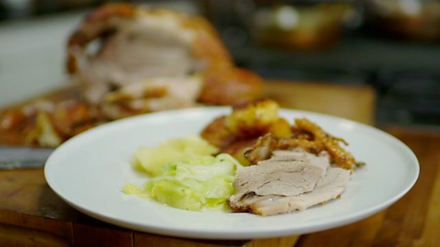 Slow roast shoulder of pork with roasties and apple sauce with hispi cabbage