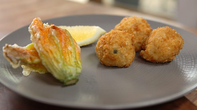 Arancini with deep-fried courgette flowers