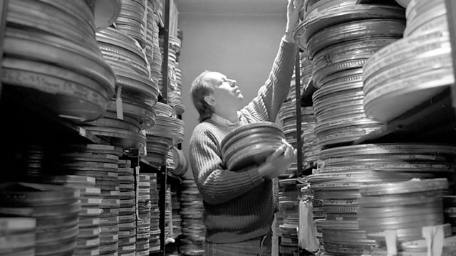 Man searching film archive