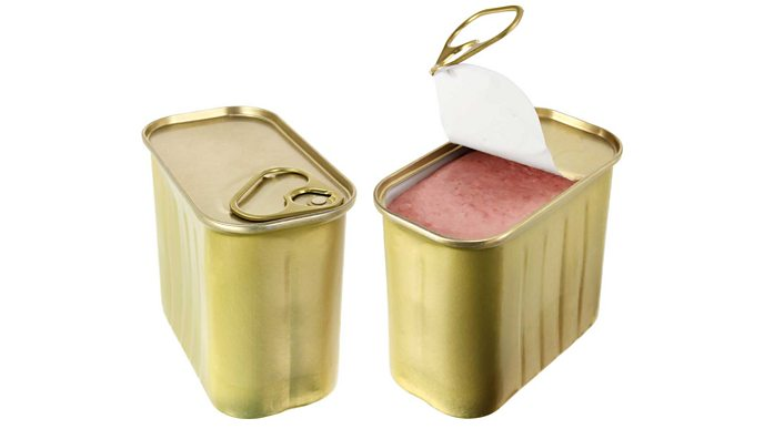 Two tins of tinned ham, one with the lid pulled up.