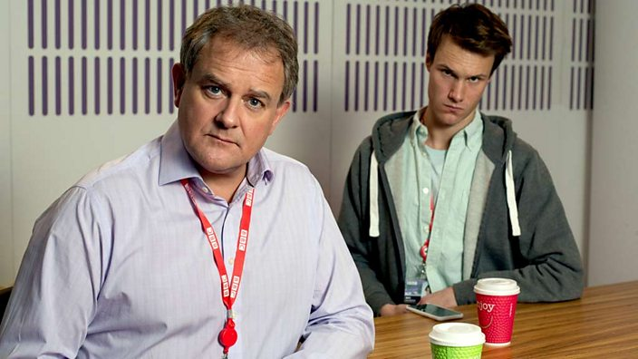 Hugh Skinner with Hugh Bonneville in W1A (credit BBC/Jack Barnes)