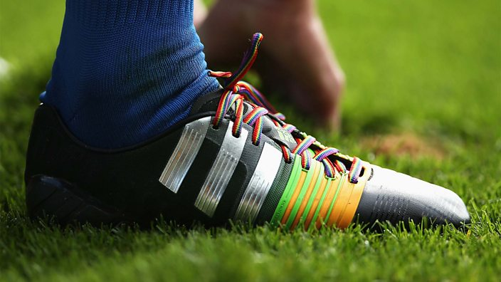 A football boot with rainbow laces