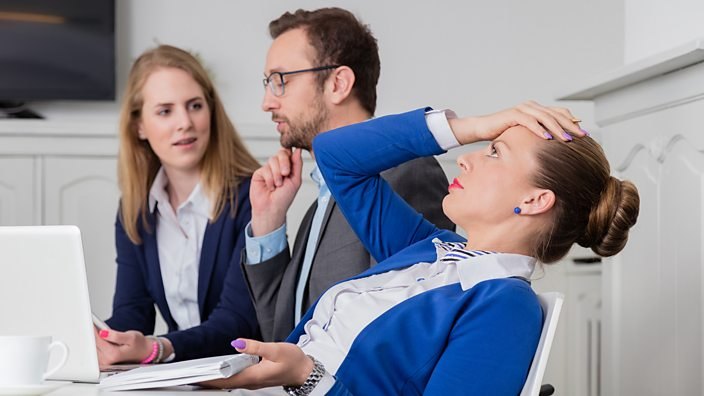 Frustrated woman in business meeting