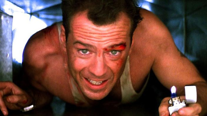 Bruce Willis in an air vent as John McClane in Die Hard