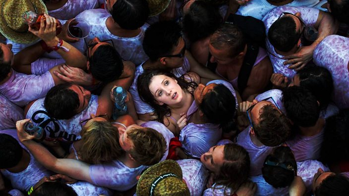 Girl in the crowd at San Fermin