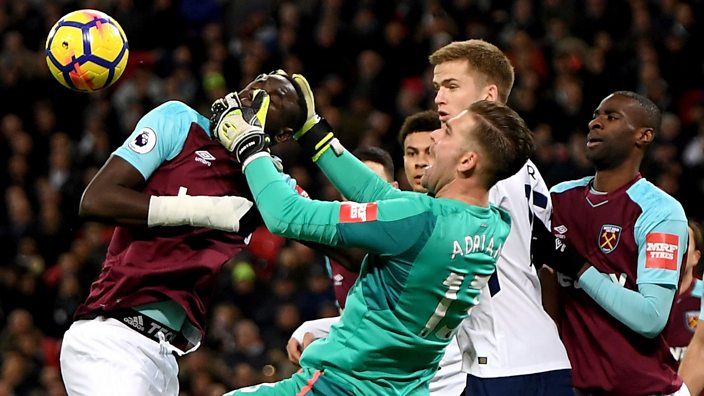 West Ham's Adrian grabs team-mate Cheikhou Kouyate