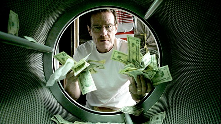 Walter White laundering money in his clothes dryer