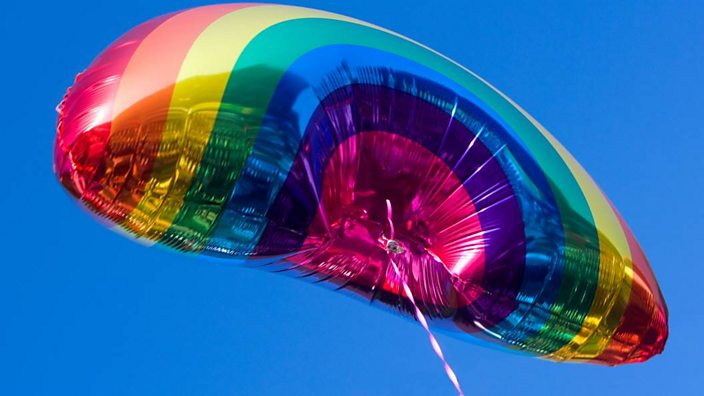 A balloon decorated as the Pride rainbow