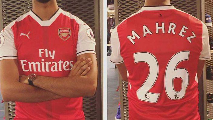 An Arsenal fan with a Riyad Mahrez shirt