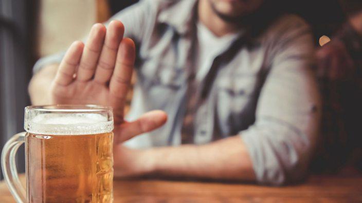 Man refusing beer