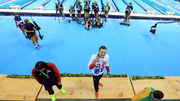 Adam peaty celebrates gold