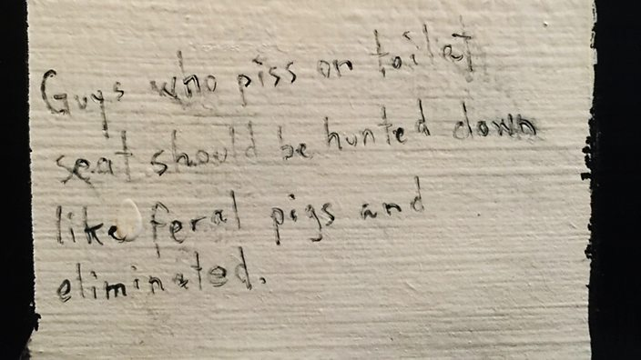 Graffiti in men's bathroom, Soho, London