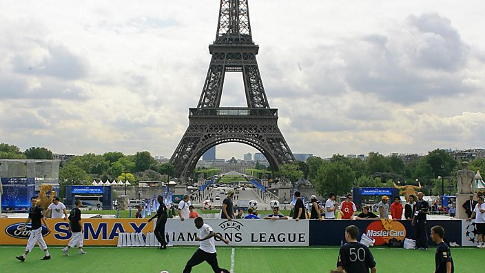 Football in front of Eiffel Tower, Paris