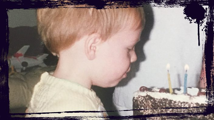A young Jack Hawksworth blowing out his birthday candles