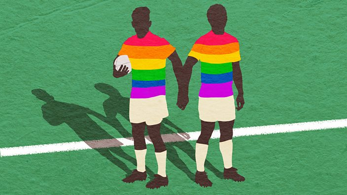 Rugby players holding hands