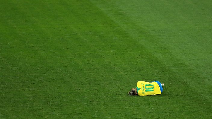 Neymar lies on the ground