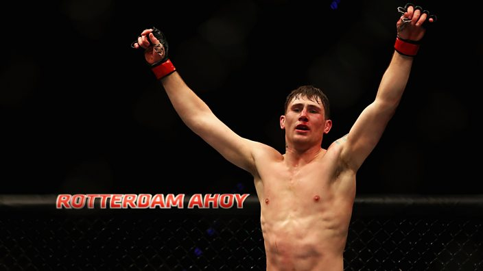 Darren Till in the UFC octagon with arms aloft