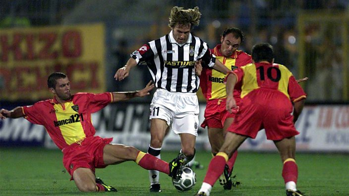 Three players try to tackle Pavel Nedved