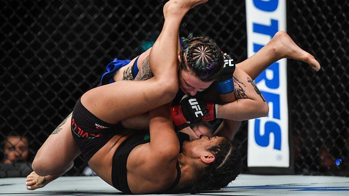 Joanne Calderwood wrestles Cynthia Calvillo to the ground