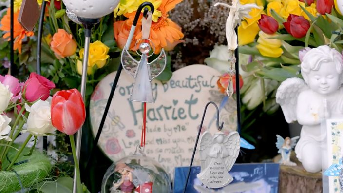 A photo showing flowers and other tributes surrounding Harriet's graveside