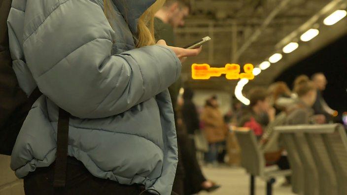 Young woman waiting at station