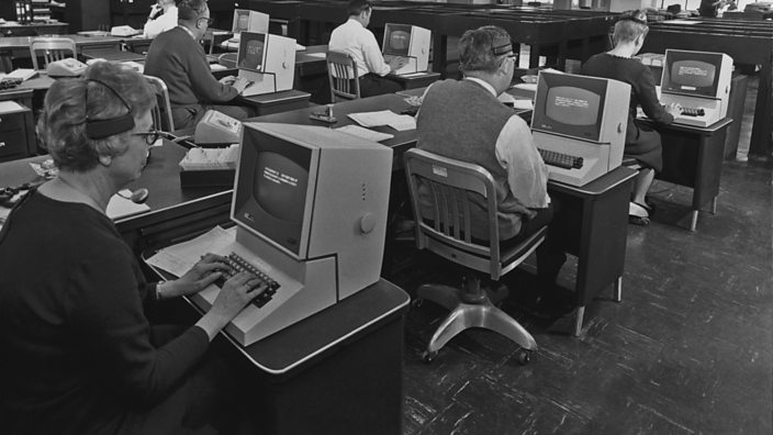 Office workers using computers in 1965