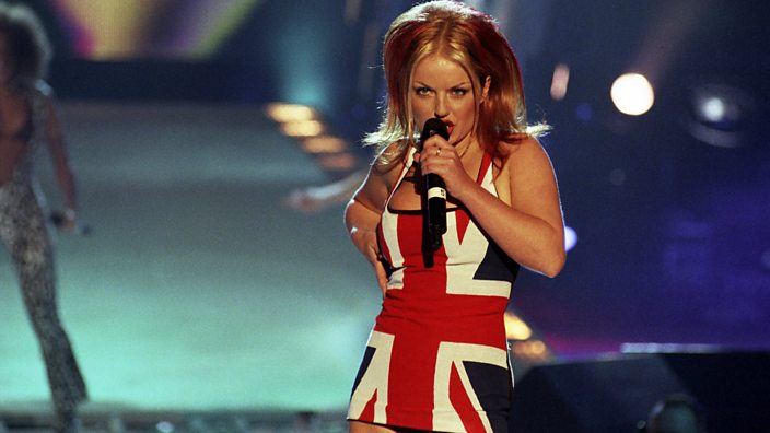 A photo of Geri Halliwell performing with the Spice Girls at the Brit Awards