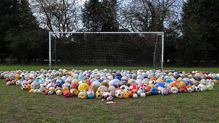 Footballs laid out on pitch