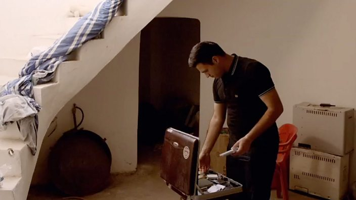 Abdullah with suitcase of films