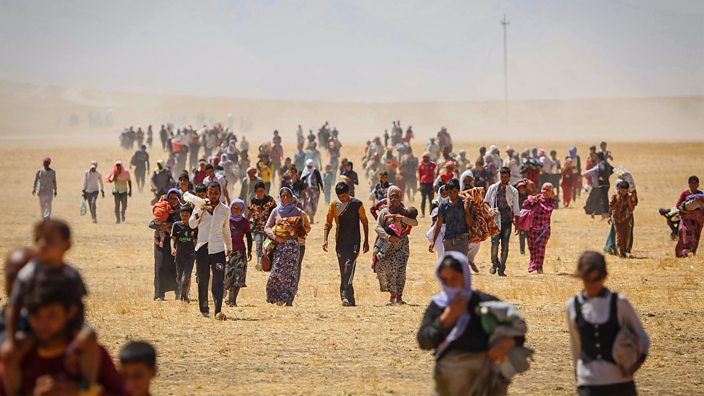 Yazidis trapped in the Sinjar mountains flee