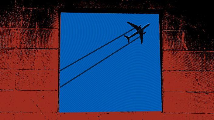 An aeroplane through a window