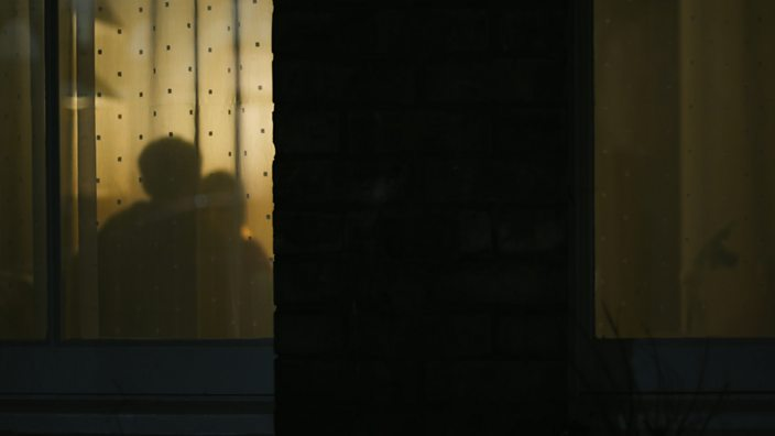 A still from the abused by my girlfriend documentary showing shadows of a couple through window