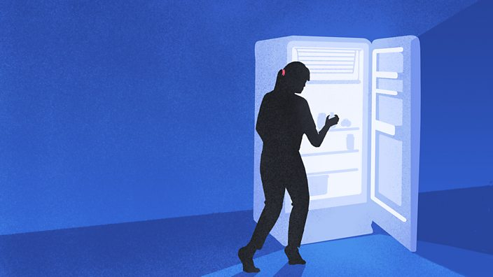 A silhouetted figure stealing some food from a glowing fridge