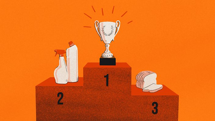 A podium with a trophy in first place, followed by cleaning products in seconds and a loaf of bread in third position