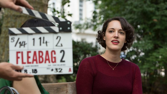 A clapper board held in front of Phoebe Waller-Bridge while filming Fleabag