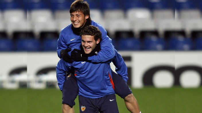 Juan Mata gives David Silva a piggy back