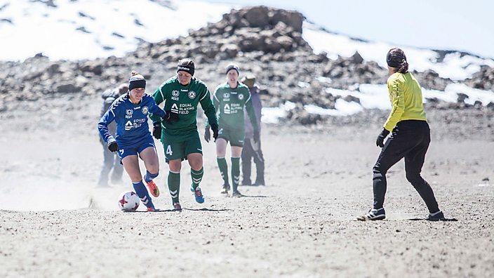 Footballers play on Mount Kilimanjaro