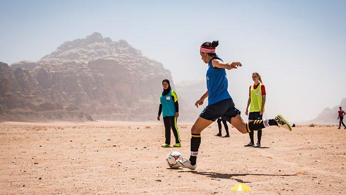 Women play football near Dead Sea