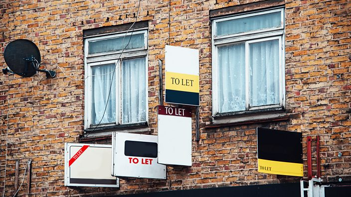 Multiple To Let signs on the wall of a block of flats