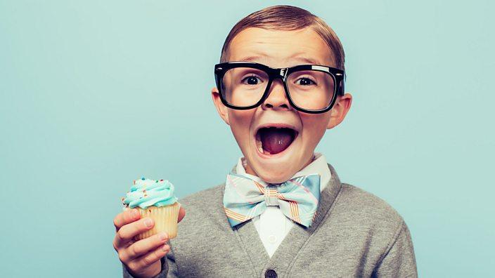 A boy holding a cupcake
